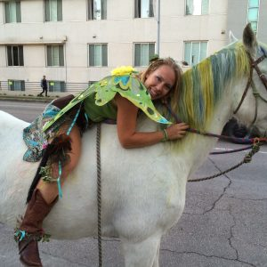 Halloween fairy poses with real life unicorn in ATX for Austin festival