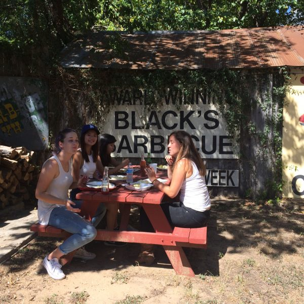 Group of visitors from Australia takes a lunch break with head guide Kathryn Hetzendorfer at Black's BBQ for a river ride to downtown Lockhart