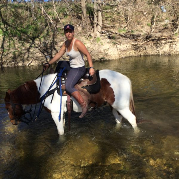 big stout paint gelding for sale pictured with trainer and natural horsemanship enthusiast, MacCoy, in the river of Brushy waters of Texas