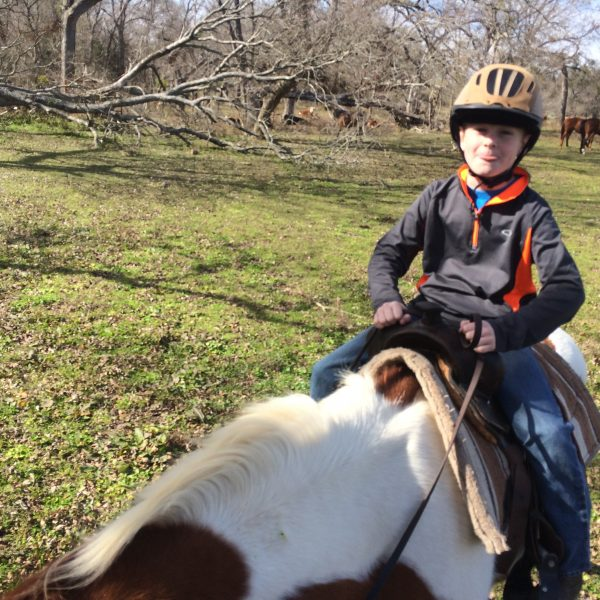 Equestrian lessons, as shown herre for youth rider with paint gelding named Teddy Bear, a sweet natured horse who with gentle guidance from trainer MacCoy because a top-notch child-friendly mount