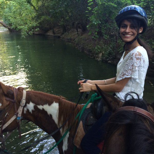 Horseback riding student hits the trail on beautiful paint mare named Annie Up