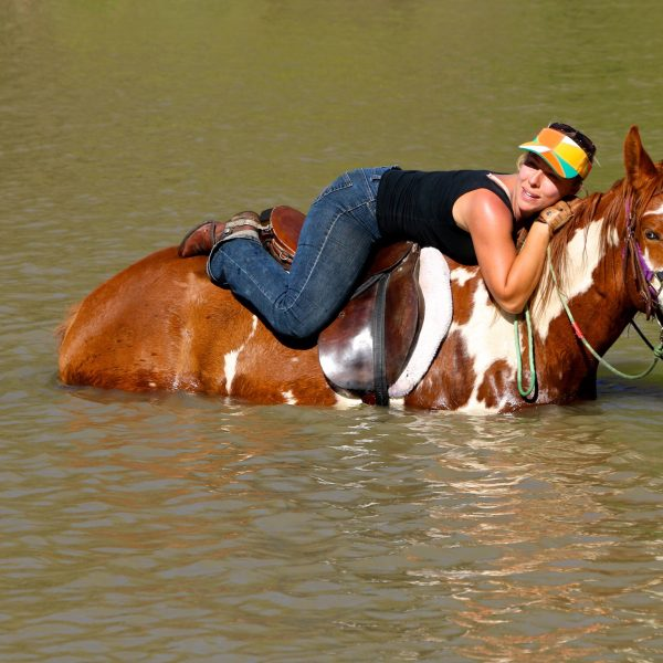 Rider lying down on the job with APHA mare, Annie Up, who is currently serving Maverick Stables as a beautiful broodmare