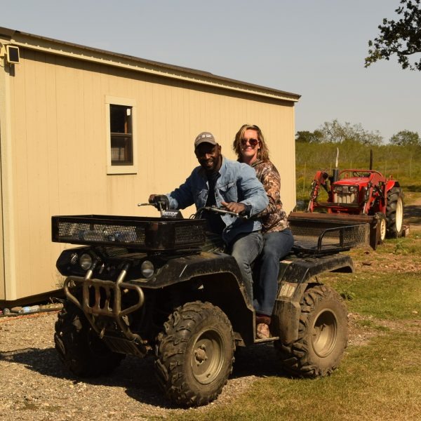 Man and woman on ATV ready to his the course and race around the track at Central Texas Premier Motocross course, Spoaks Motopark near Southeast Austin