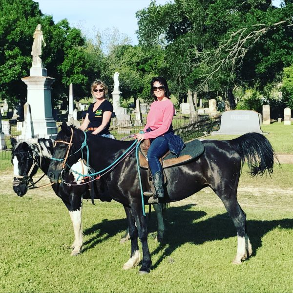 Penelope, for sale, pictured with paint mare near Austin TX on trail ride